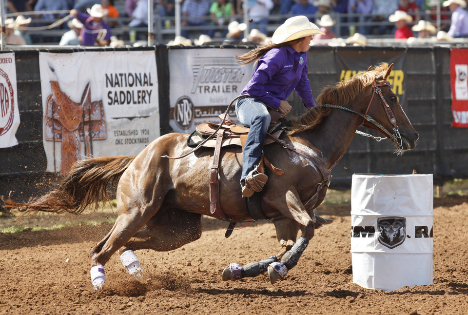 Photo - Stephanie Beers, from Liberty Hill, TX, competes in the Barrel Racing event during Tuesday's performances at the International Youth Finals Rodeo at the Shawnee Heart of Oklahoma Exposition Center in Shawnee, OK, Tuesday, July 8, 2014,  Photo by Paul Hellstern, The Oklahoman