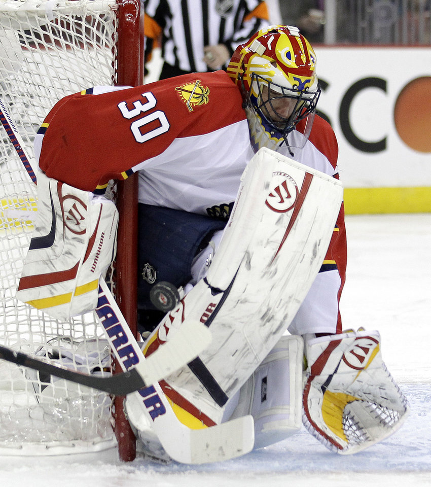 Photo -   Florida Panthers goalie Scott Clemmensen makes a save during the second period of Game 3 of a first-round NHL hockey Stanley Cup playoff series against the New Jersey Devils, Tuesday, April 17, 2012, in Newark, N.J. (AP Photo/Julio Cortez)