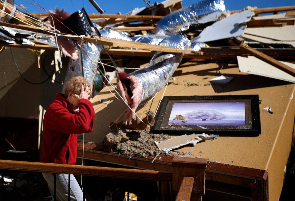 Photo -  Carole Beckett reacts as she sorts through belongings at her home after a tornado moved through Woodward, Okla., Sunday, April 15, 2012. Photo by Bryan Terry, The Oklahoman