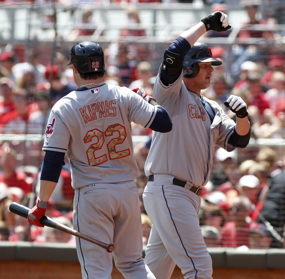 Photo - Cleveland Indians' Jason Giambi, right, is congratulated by Jason Kipnis, left, after Giambi hit a solo home run off Cincinnati Reds starting pitcher Mike Leake in the eighth inning during a baseball game, Monday, May 27, 2013, in Cincinnati. The Reds won 4-2. (AP Photo/David Kohl)