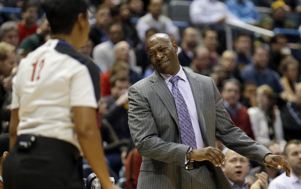 Sacramento Kings head coach Keith Smart, right, reacts to a call by referee Violet Palmer, left, during the second half of an NBA basketball game against the Milwaukee Bucks, Wednesday, Dec. 12, 2012, in Milwaukee. (AP Photo/Jeffrey Phelps)