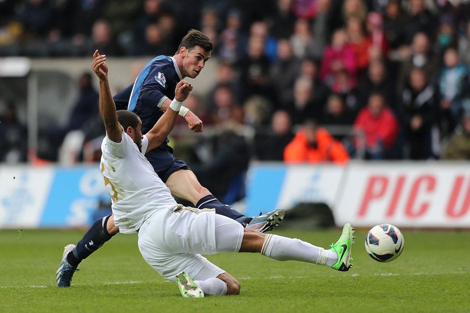 Tottenham Hotspur's Gareth Bale shoots during the English Premier League match at the Liberty Stadium, Swansea, England, Saturday March 30, 2013. (AP Photo/PA, Nick Potts) UNITED KINGDOM OUT