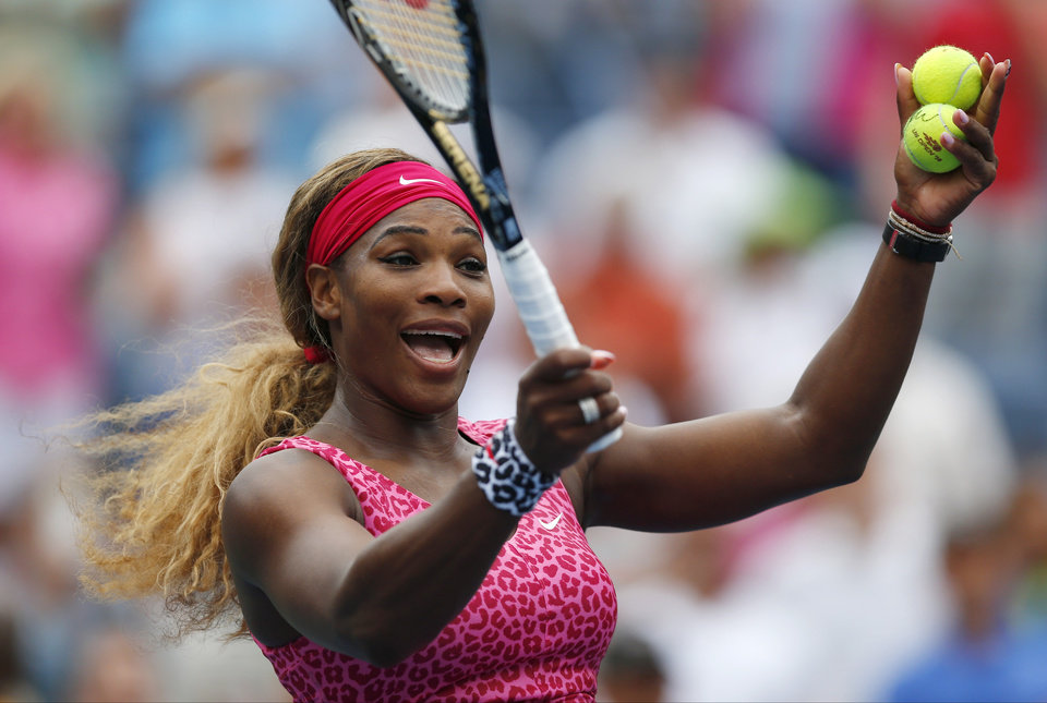 Photo - Serena Williams, of the United States, reacts to the crowd as she prepares to hit balls into the stands after defeating Varvara Lepchenko, of the United States, during the third round of the 2014 U.S. Open tennis tournament, Saturday, Aug. 30, 2014, in New York. (AP Photo/Matt Rourke)