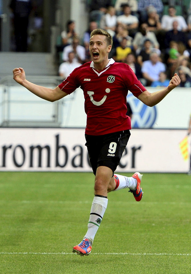 Photo -   Hannover's Artur Sobiech celebrates after scoring their side's second goal during the German first division Bundesliga soccer match between VfL Wolfsburg and Hannover 96 in Wolfsburg, Germany, Sunday, Sept. 2, 2012. (AP Photo/dapd, Nigel Treblin) - NO MOBILE USE UNTIL 2 HOURS AFTER THE MATCH, WEBSITE USERS ARE OBLIGED TO COMPLY WITH DFL-RESTRICTIONS, SEE INSTRUCTIONS FOR DETAILS -