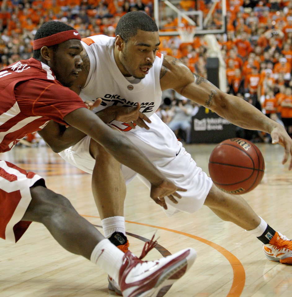 Photo - Oklahoma State's Marshall Moses (33) and Oklahoma's Calvin Newell Jr. (11) go for the ball during the Bedlam men's college basketball game between the University of Oklahoma Sooners and Oklahoma State University Cowboys at Gallagher-Iba Arena in Stillwater, Okla., Saturday, February, 5, 2011. Photo by Bryan Terry, The Oklahoman