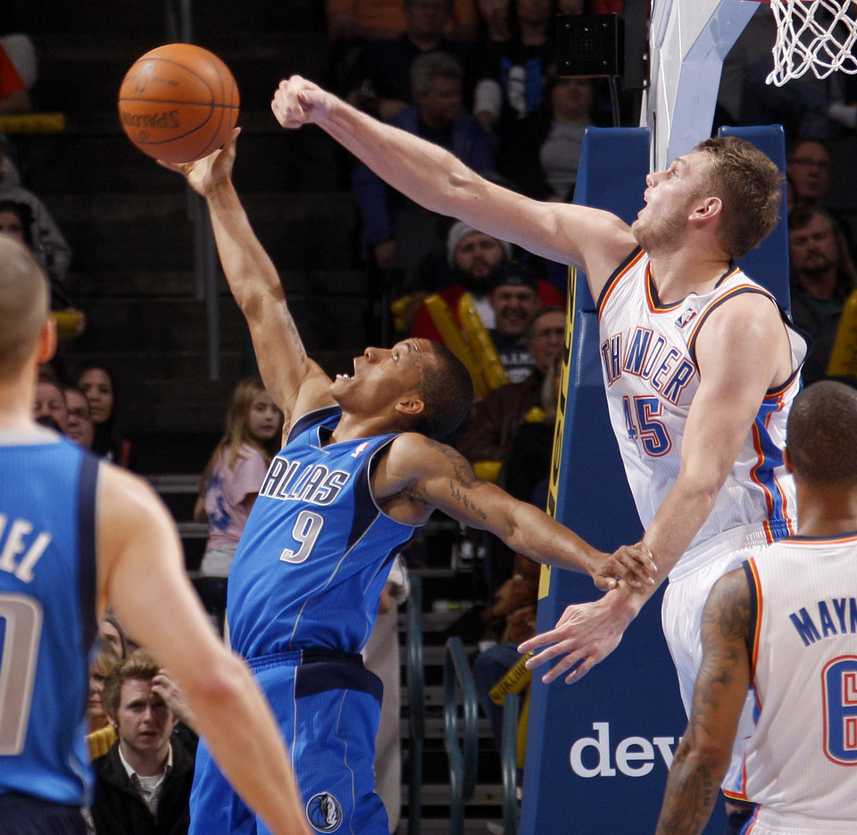 Oklahoma City's' Cole Aldrich (45) blocks the shot of Dallas' Jerome Randle (9) during a preseason NBA game between the Oklahoma City Thunder and the Dallas Mavericks at Chesapeake Energy Arena in Oklahoma City, Tuesday, Dec. 20, 2011. Photo by Bryan Terry, The Oklahoman