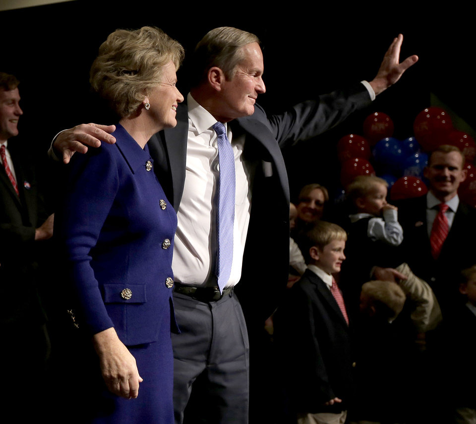 U.S. Senate candidate, Rep. Todd Akin, R-Mo., and his wife Lulli wave to supporters after Akin gave his concession speech to U.S. Sen. Claire McCaskill, D-Mo. Tuesday, Nov. 6, 2012, in Chesterfield, Mo. (AP Photo/Charlie Riedel)