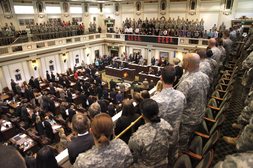 Photo -  Top: Current members of the Oklahoma National Guard and former members of the 45th Infantry (Thunderbird) Division listen to Lt. Gov. Todd Lamb speak Tuesday on the state House floor.  Photos by Paul Hellstern, The Oklahoman   PAUL HELLSTERN -