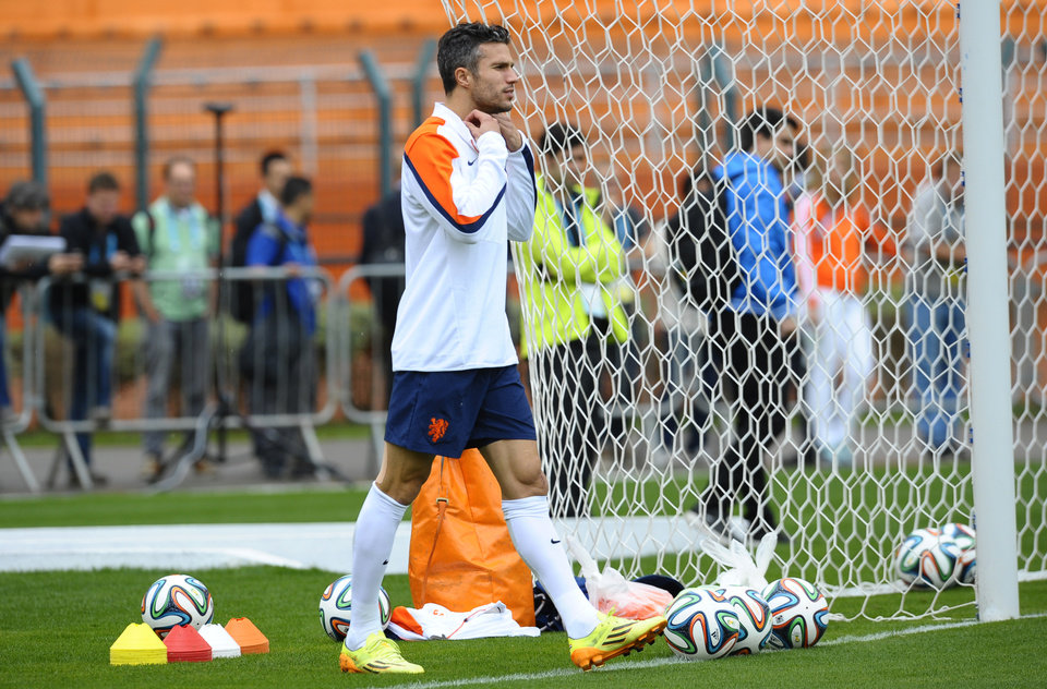 Photo - Netherlands's Robin van Persie arrives for a training session one day before their World Cup semifinal soccer match against Argentina at the Paulo Machado de Carvalho Stadium in Sao Paulo, Brazil, Tuesday, July 8, 2014. (AP Photo/Manu Fernandez)