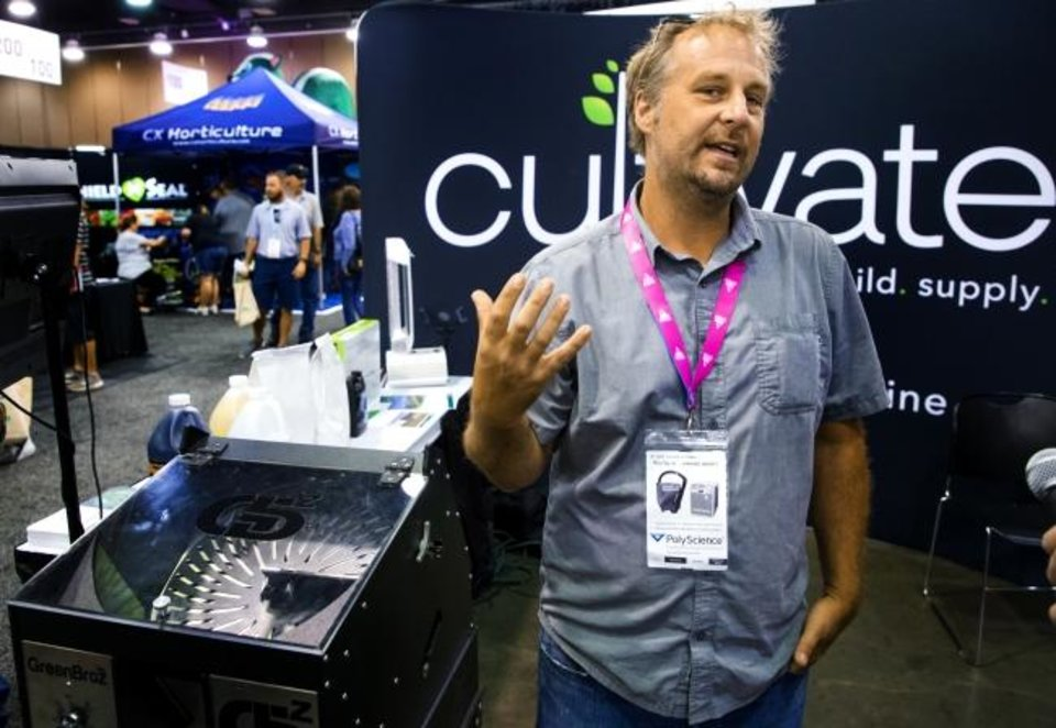 Photo -  Chip Baker, founder of Cultivate Garden Supply, speaks Friday about the products supplied by his company during the CannaCon convention. [CHRIS LANDSBERGER/THE OKLAHOMAN]