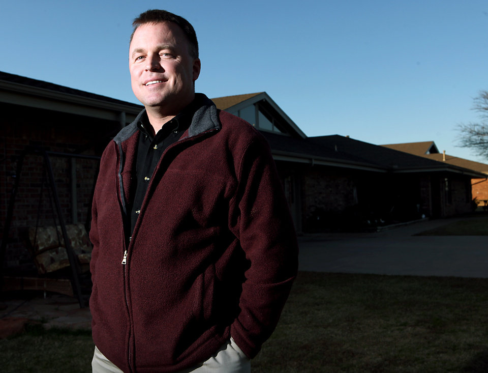 Photo - Brent Thackerson, administrator of Boys Ranch Town in Edmond, stands outside one of the cottages at the boys home, 5100 SE 33, on Monday, Nov. 30, 2009. By John Clanton, The Oklahoman ORG XMIT: KOD