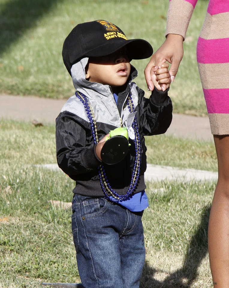Two year old Anthony Gibbs watches the University of Central Oklahoma's homecoming parade in Edmond, OK, Saturday, November 3, 2012,  By Paul Hellstern, The Oklahoman