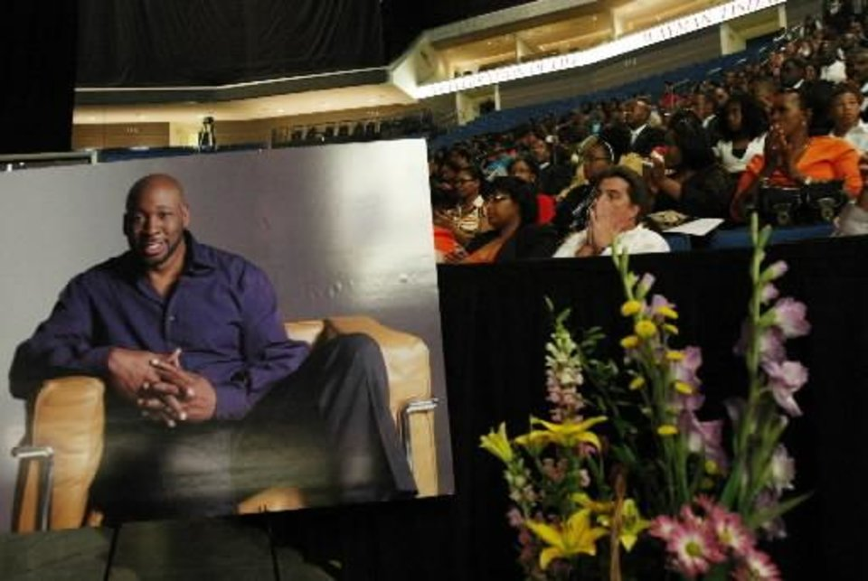 Photo - A portrait of  Wayman  Tisdale is shown at his memorial service in Tulsa, Okla., Thursday May 21, 2009. Thousands of people, including former NBA players, pop musicians and former coaches, packed an arena for a spirited public memorial honoring  Tisdale, who died last week after a long battle with cancer. He was 44. (AP Photo/Cory Young, Pool)