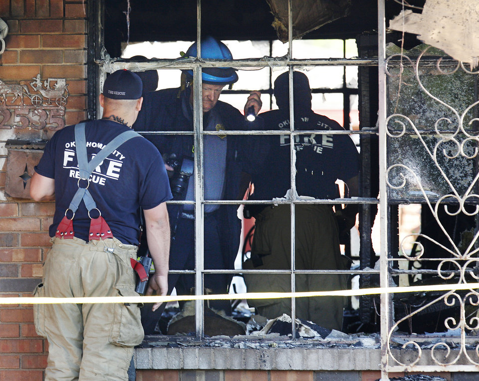 Photo - Oklahoma City  firemen, crime scene unit and arson investigators search through the aftermath of a fatality house fire at 2535 SW 51 Street in Oklahoma City on Monday. Photo by Paul B. Southerland, The Oklahoman  PAUL B. SOUTHERLAND