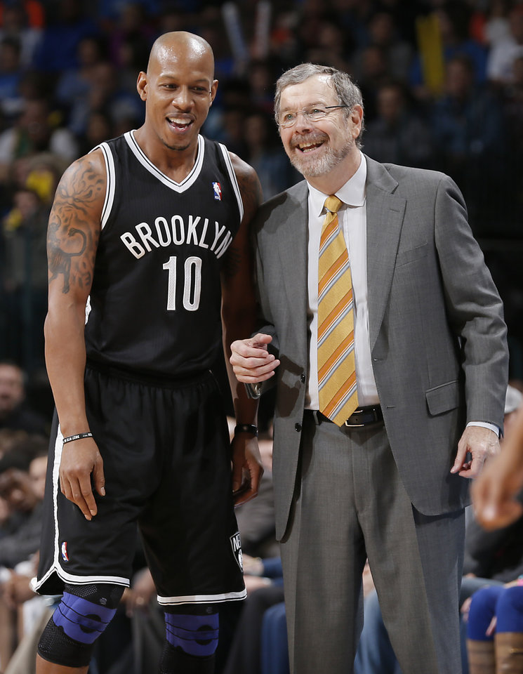 Photo - Brooklyn Nets' Keith Bogans (10) and coach P.J. Carlesimo laugh on the sideline during the NBA basketball game between the Oklahoma City Thunder and the Brooklyn Nets at the Chesapeake Energy Arena on Wednesday, Jan. 2, 2013, in Oklahoma City, Okla. Photo by Chris Landsberger, The Oklahoman