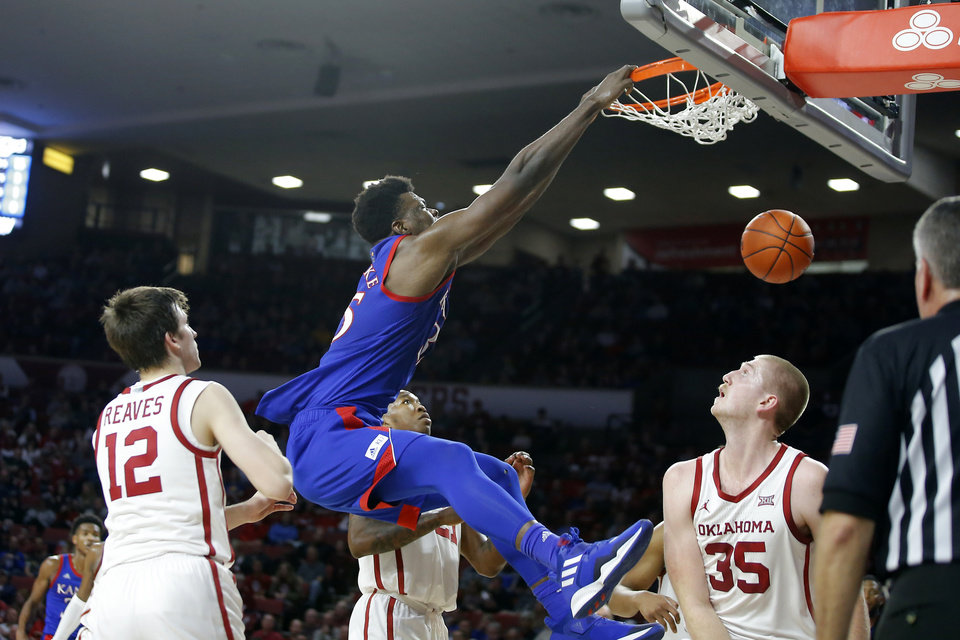 Photo - Kansas' Udoka Azubuike (35) dunks the ball between Oklahoma's Austin Reaves (12), Kristian Doolittle (21) and Brady Manek (35) during an NCAA college basketball game between the University of Oklahoma Sooners (OU) and the University of Kansas Jayhawks at Lloyd Noble Center in Norman, Okla., Tuesday, Jan. 14, 2020. Oklahoma lost 66-52.  [Bryan Terry/The Oklahoman]