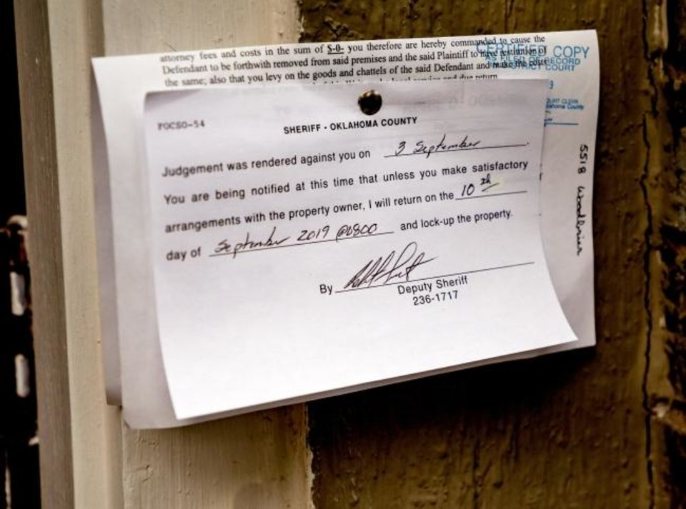Photo -  Eviction notices, like this one pictured last September, could be seen more often this fall as residents and landlords deal with the fallout of the coronavirus and its impact on renters. [Chris Landsberger/The Oklahoman]
