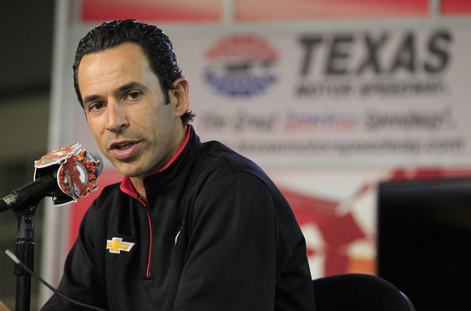 Photo - Indycar driver Helio Castroneves speaks at Texas Motor Speedway on Wednesday, March 19, 2014, in Fort Worth, Texas, where a high-definition video board was unveiled. The screen is 218 feet wide and about 95 feet high. It is about 125 feet above ground level in the middle of the backstretch at the 1 1/2-mile track. (AP Photo/Fort Worth Star Telegram, Paul Moseley) MAGS OUT (FORT WORTH WEEKLY, 360 WEST); INTERNET OUT