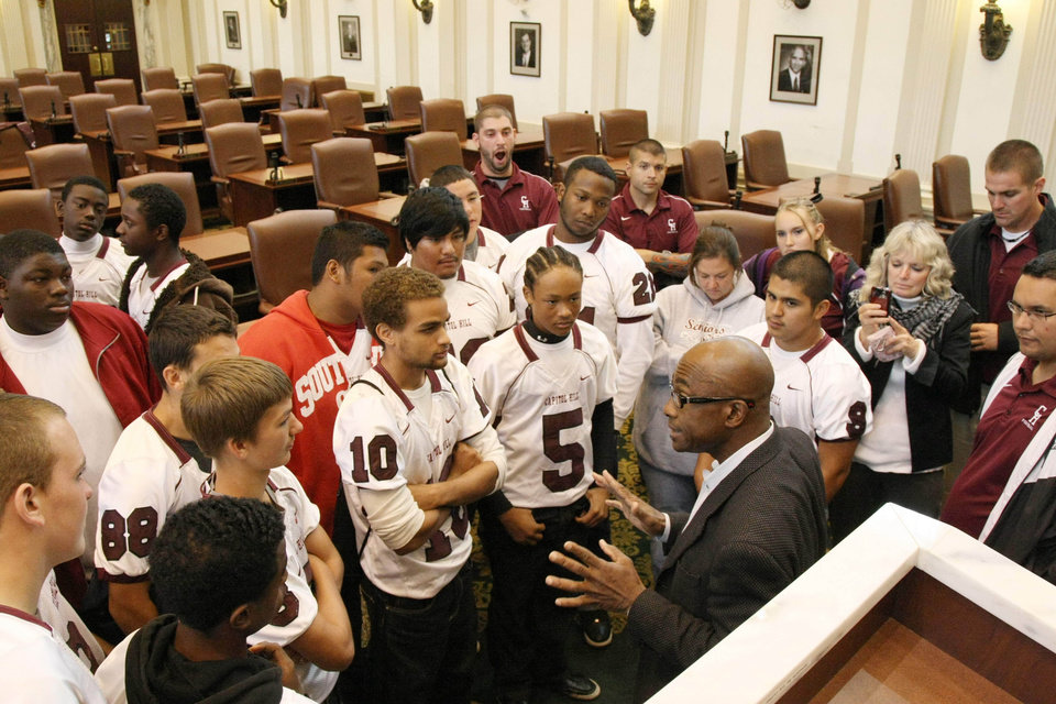 Photo - Former Oklahoma running back Joe Washington speaks to members of the Capitol Hill football team on Thursday, Oct. 27, 2011, at the state capitol in Oklahoma City. PHOTO PROVIDED KOD