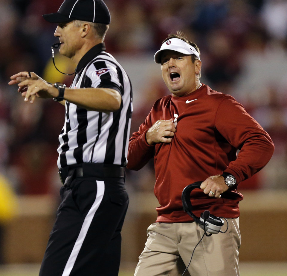 Photo - Bob Stoops yells at the officials about a call against the Sooners during the college football game between the University of Oklahoma Sooners (OU) and the Texas Christian University Horned Frogs (TCU) at the Gaylord Family-Oklahoma Memorial Stadium on Saturday, Oct. 5, 2013 in Norman, Okla.   Photo by Chris Landsberger, The Oklahoman