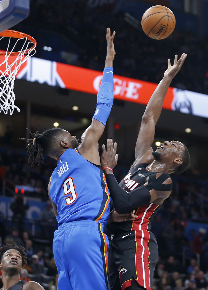 Photo - Miami's Bam Adebayo (13) shoots over Oklahoma City's Nerlens Noel (9) during an NBA basketball game between the Oklahoma City Thunder and the Miami Heat at Chesapeake Energy Arena in Oklahoma City, Friday, Jan. 17, 2020. Oklahoma State lost 76-64. Oklahoma City lost 115-108. [Bryan Terry/The Oklahoman]
