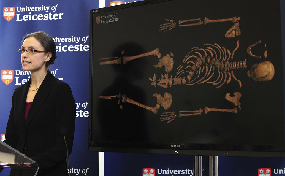 Photo - Jo Appleby, a lecturer in Human Bioarchaeology, at University of Leicester, School of Archaeology and Ancient History, who led the exhumation of the remains found during a dig at a Leicester car park, speaks at the university Monday Feb. 4, 2013. Tests have established that a skeleton found , pictured behind, are