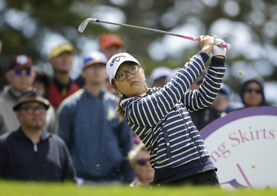 Photo - Lydia Ko, of New Zealand, follows her shot from the third tee of the Lake Merced Golf Club during the third round of the Swinging Skirts LPGA Classic golf tournament on Saturday, April 26, 2014, in Daly City, Calif. (AP Photo/Eric Risberg)