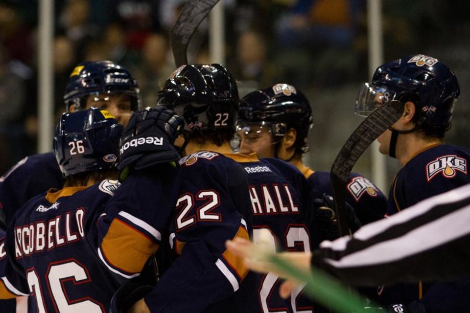 Barons players celebrate a goal by Taylor Hall, center, during Thursday, Dec. 27 game against the Texas Stars. PHOTO BY JOSH RASMUSSEN, TEXAS STARS