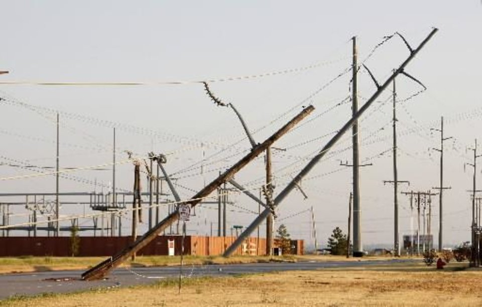 Photo - Power lines down and poles leaning along N. Rockwell Blvd. south of Memorial Road in Oklahoma City Tuesday, Aug. 9, 2011. A thunderstorm moved through the area Monday evening causing storm damage. Photo by Paul B. Southerland