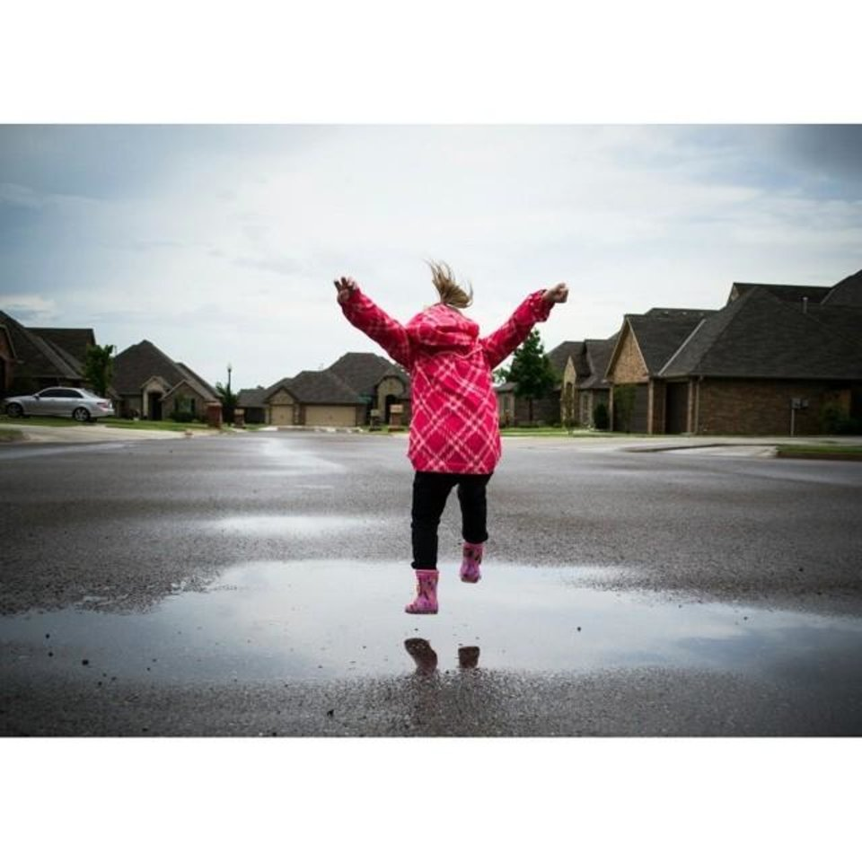 Photo - - Krista Gatz (@kriskilla) - 24 My 3 and half year old was watching it rain all morning out the front door and when it finally stopped we put on some rain boots and jumped in the puddles.  To me, this picture shows how quickly the Oklahoma weather can change. We went from being couped up all morning to spending the rest of the day playing outside and making memories! I love my Oklahoma.