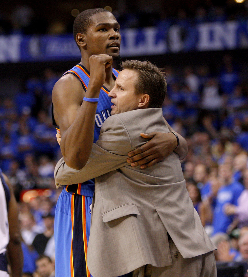 Oklahoma City\'s Kevin Durant celebrates with coach Scott Brooks after winning Game 4 of the first round in the NBA playoffs between the Oklahoma City Thunder and the Dallas Mavericks at American Airlines Center in Dallas, Saturday, May 5, 2012. Oklahoma City won 103-97. Photo by Bryan Terry, The Oklahoman