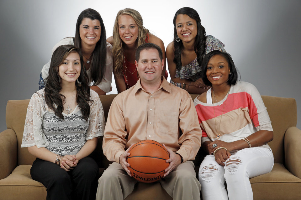 The Oklahoman's Super 5 girls high school basketball players and coach: from left, top row, Taylor Cooper of Shawnee, Alie Decker of Edmond Memorial, Kelsee Grovey of Shawnee; bottom row, Lakota Beatty of Anadarko, Coach Mike Barton of Fairview and Courtney Walker of Edmond Santa Fe, photographed at the OPUBCO studio in Oklahoma City, Wednesday, March 28, 2012. Photo by Nate Billings, The Oklahoman