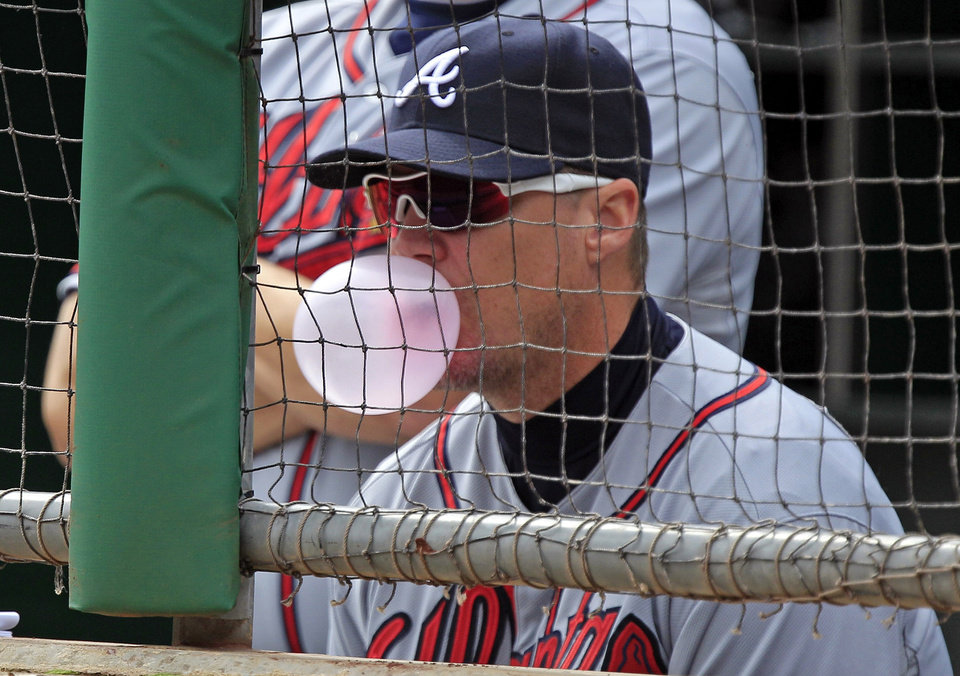 Atlanta Braves Chipper Jones sits in the dugout during the first inning of a baseball game against the Pittsburgh Pirates in Pittsburgh Wednesday, Oct. 3, 2012. (AP Photo/Gene J. Puskar)