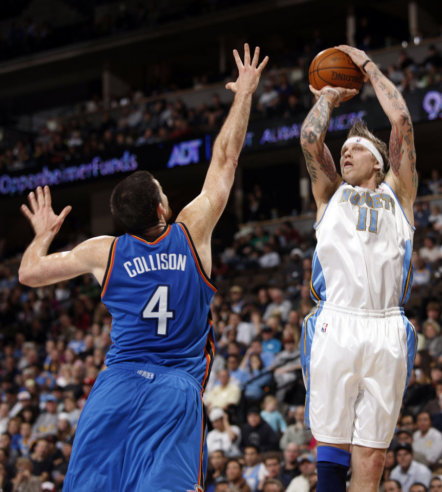 Photo - Denver Nuggets forward Chris Andersen, right, goes up for a shot as Oklahoma City Thunder forward Nick Collison covers in the fourth quarter of the Nuggets' 102-93 victory in an NBA basketball game in Denver on Monday, Dec. 14, 2009. (AP Photo/David Zalubowski) ORG XMIT: CODZ106