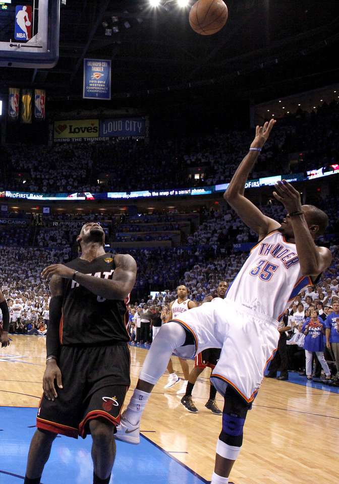Photo - Oklahoma City's Kevin Durant (35) takes a last second shot as Miami's LeBron James (6) during Game 2 of the NBA Finals between the Oklahoma City Thunder and the Miami Heat at Chesapeake Energy Arena in Oklahoma City, Thursday, June 14, 2012. Photo by Sarah Phipps, The Oklahoman