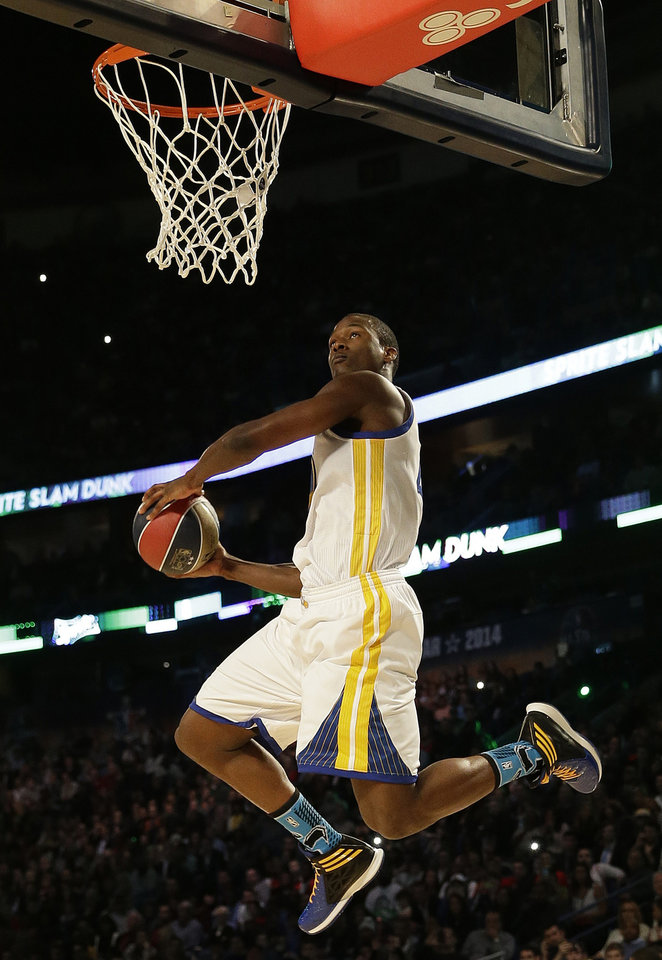 Photo - CORRECTS TO HARRISON BARNES, INSTEAD OF PAUL GEORGE - Golden State Warriors' Harrison Barnes participates in the slam dunk contest during the skills competition at the NBA All Star basketball game, Saturday, Feb. 15, 2014, in New Orleans. (AP Photo/Gerald Herbert)