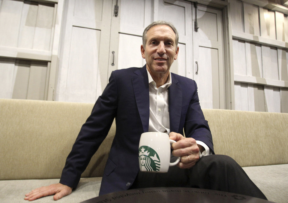 Photo - Starbucks CEO Howard Schultz poses for the photographer during a press conference in Bangkok, Thailand, Monday, May 13, 2013. Schultz, visiting Bangkok this week to mark the coffee giant's 15 year anniversary of opening in Thailand, said Monday the coffee chain's first stores in India and Vietnam have been received positively and it might soon be time to give Myanmar a shot too. (AP Photo/Sakchai Lalit)