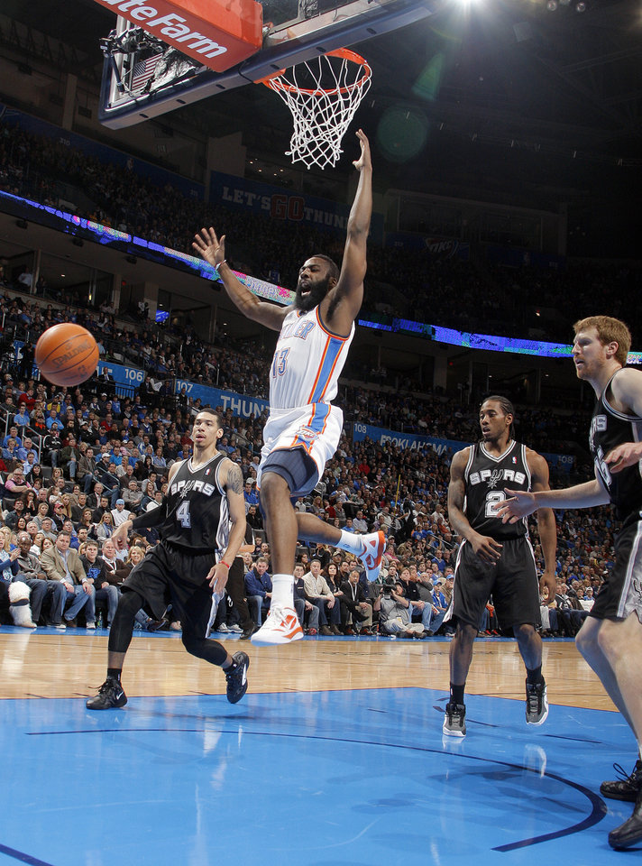 Photo - Oklahoma City Thunder's James Harden (13) reacts after loosing control of the ball during the the NBA basketball game between the Oklahoma City Thunder and the San Antonio Spurs at the Chesapeake Energy Arena in Oklahoma City, Sunday, Jan. 8, 2012. Photo by Sarah Phipps, The Oklahoman