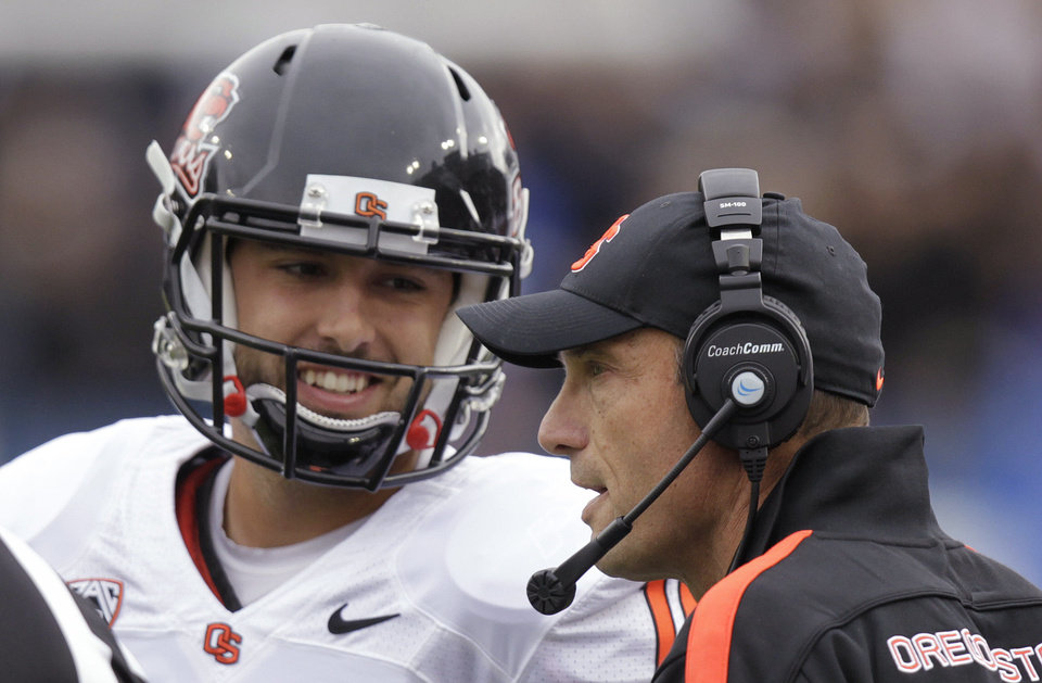 Oregon State coach Mike Riley, show here talking with quarterback Cody Vaz,will try to pull off the upset Saturday at Stanford. (AP Photo/Rick Bowmer) Rick Bowmer - AP