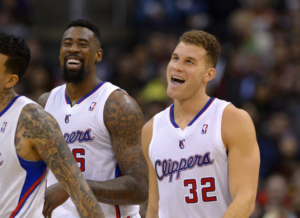 Los Angeles Clippers forward Blake Griffin, right, and center DeAndre Jordan laugh during the first half of an NBA basketball game against the Toronto Raptors, Friday, Feb. 7, 2014, in Los Angeles. (AP Photo/Mark J. Terrill)