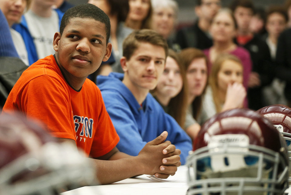 Photo - Trayvon Gamble, left, sits with other athletes before the college signing day ceremony for student athletes at Edmond Memorial High School in Edmond, Okla., Wednesday, Feb. 5, 2014. Gamble signed to play football at Langston. Photo by Nate Billings, The Oklahoman