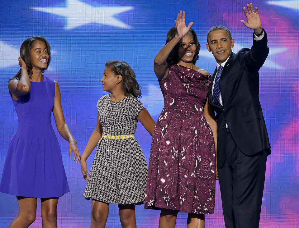 Photo -   President Barack Obama and First lady Michelle Obama waves to delegates as their daughters Malia and Sasha join them at the Democratic National Convention in Charlotte, N.C., on Thursday, Sept. 6, 2012. (AP Photo/J. Scott Applewhite)