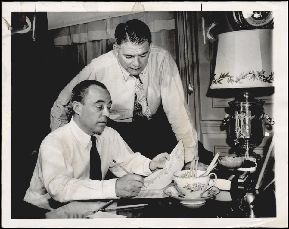 Photo -  Richard Rodgers (seated) and Oscar Hammerstein II (standing), 1949. [Oklahoma Historical Society Research Division]