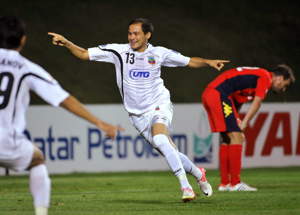 Bunyodkor's Lutfulla Turaev, center, celebrates his score against Adelaide United's team during their 2012 AFC Champions League quarter-final second leg match in Tashkent, Uzbekistan, Wednesday, Oct. 3, 2012. (AP Photo/Anvar Ilyasov)