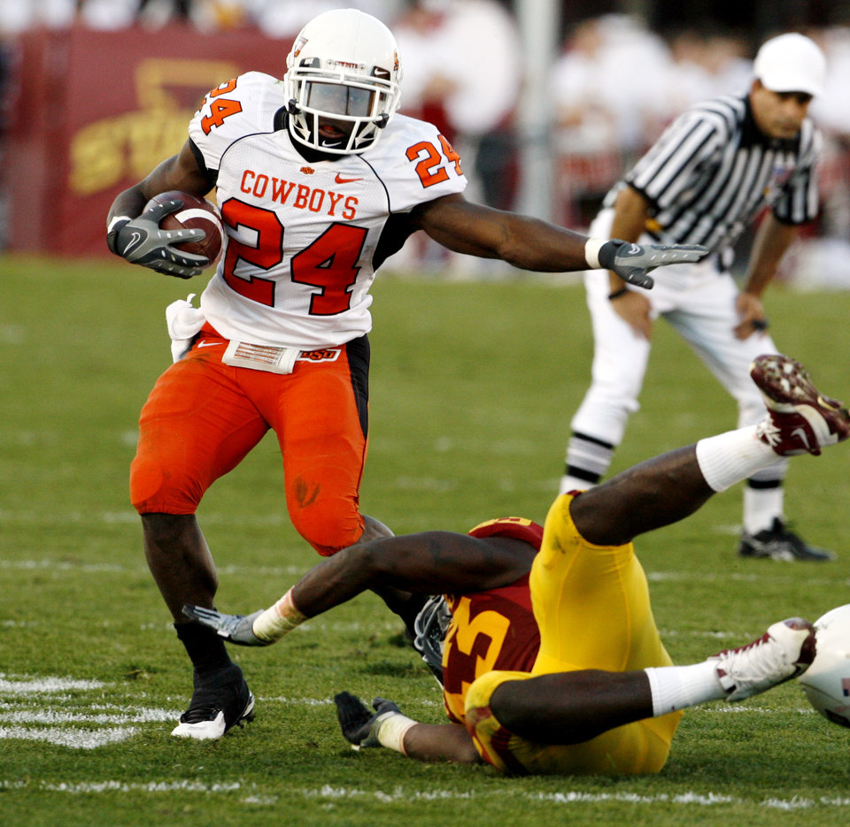 Photo - Kendall Hunter (24) avoids the hit of Fred Garrin (43) in the second half during the college football game as the Oklahoma State University (OSU) Cowboys play the Iowa State University (ISU) Cyclones at Jack Trice Stadium on Saturday, November 7, 2009, in Ames, Iowa. Photo by Steve Sisney, The Oklahoman ORG XMIT: KOD