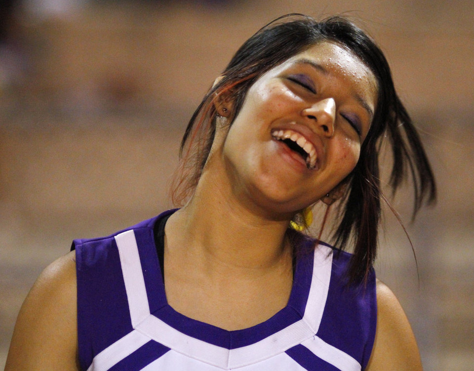 A NWC cheerleader dances to the band at the Northwest Classen vs. Western Heights high school football game at Taft Stadium Thursday, September 20, 2012. Photo by Doug Hoke, The Oklahoman