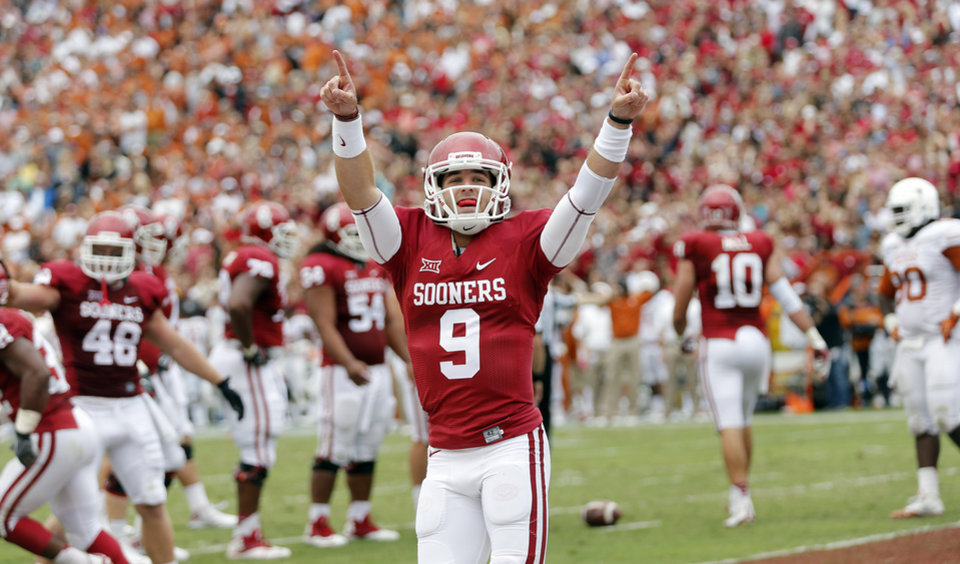 Photo - Oklahoma's Trevor Knight (9) reacts after a touchdown during the college football game between the University of Oklahoma Sooners (OU) and the University of Texas Longhorns (UT) during the Red River Showdown at the Cotton bowl in Dallas, Texas on Saturday, Oct. 11, 2014. Photo by Chris Landsberger, The Oklahoman