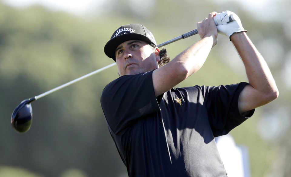 Photo - Pat Perez tees off on the 18th hole of the South Course at Torrey Pines during the third round of the Farmers Insurance Open golf tournament Saturday, Jan. 25, 2014, in San Diego. (AP Photo/Lenny Ignelzi)