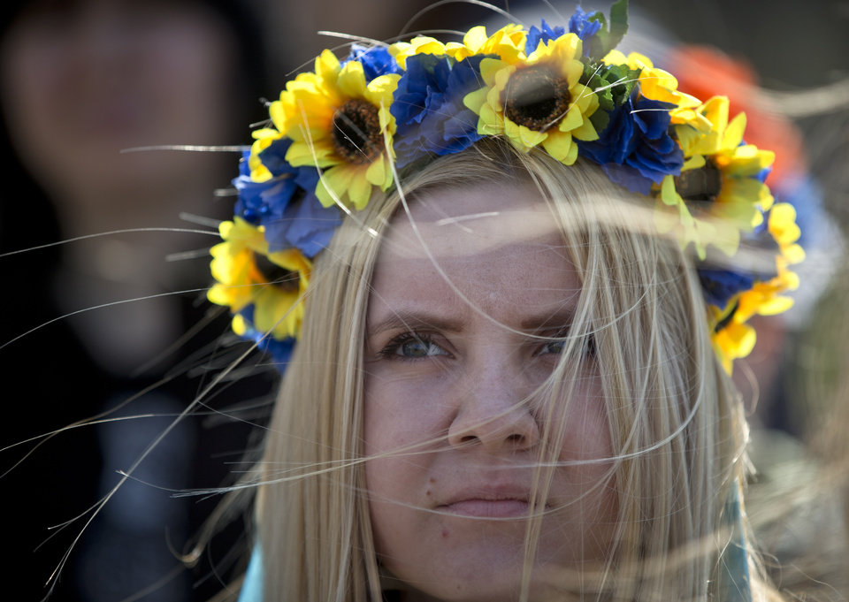Photo - A pro-Ukrainian demonstrator attends a rally, in Simferopol, Ukraine, Saturday, March 15, 2014. Tensions are high in the Black Sea peninsula of Crimea, where a referendum is to be held Sunday on whether to split off from Ukraine and seek annexation by Russia. (AP Photo/Vadim Ghirda)