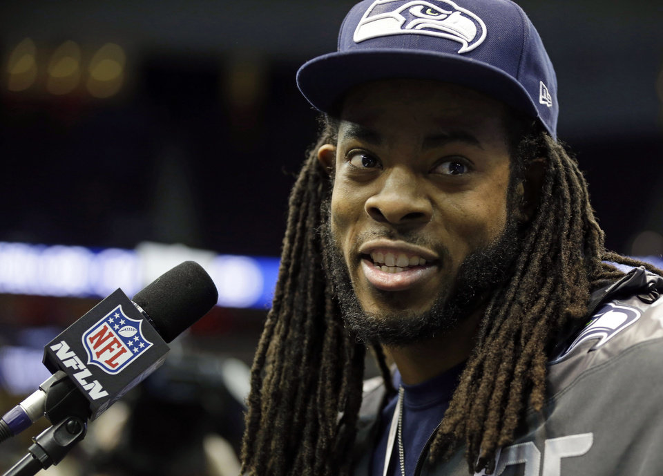 Photo - Seattle Seahawks' Richard Sherman answers a question during media day for the NFL Super Bowl XLVIII football game Tuesday, Jan. 28, 2014, in Newark, N.J. (AP Photo/Jeff Roberson)
